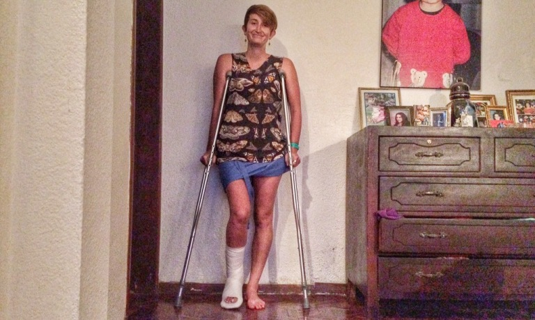 Crutches and all.